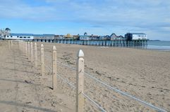 Old Orchard Beach. Maine, at low tide on a cold winter day royalty free stock image