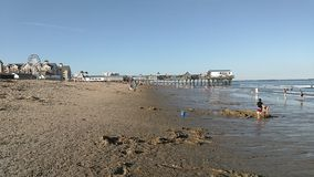 Old Orchard beach in Maine. A view of the beach and pier at Old Orchard Beach in Maine stock footage