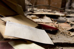 Old order papers. Papers from an old factory, lying on the floor of an abandoned industrial building Stock Photo