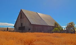 Old Oregon Barn. This is a very cool old Barn I came across in centro Oregon it was a beautiful day with the sun reflecting off the roof Stock Image