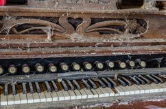 Old organ with cobwebs. And dust Royalty Free Stock Images