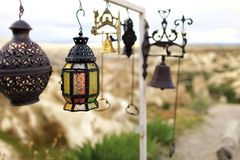 Old oriental brass oil lamp with stained glass. On a blurred background of different antiquities stock photos