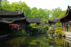 Old oriental structures with garden and fish pond Stock Photos