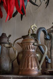 Old oriental teapots. On a background of gray wall Stock Image
