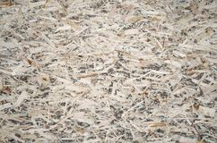 An old oriented strand board OSB , fiberboard background of texture. Sheet is made of brown wood chips pressed together into a woo. Den floor stock photography