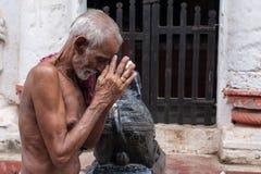 Old Oriyan Priest Praying. Royalty Free Stock Photography