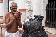 Old Oriyan Priest Praying. Stock Photo