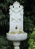 Old, ornate, embossed marble, ottoman fountain Stock Photos