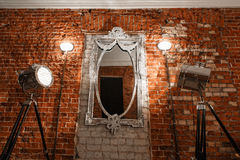 Old ornate frames on mirror glas hanging  a brick wall. Old ornate frames on mirror glas hanging on a brick wall Royalty Free Stock Photos