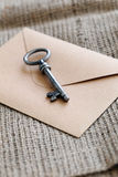 Old, ornate key with envelope Stock Photography