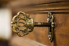 Old ornate key. Macro shot of an antique and weathered vintage key in his keyhole Stock Images