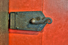 Old ornate metal lock on red door Royalty Free Stock Photos