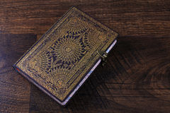 Old ornate notebook on wood background Stock Image