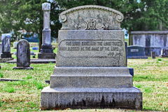 Old ornate tombstone Book of Job verse. Old granite tombstone with book of job verse Stock Images