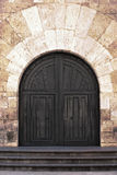 Old ornate wooden doors in Valladolid, Spain. Royalty Free Stock Photo