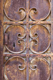 Old ornated and rusted metal door Royalty Free Stock Photos