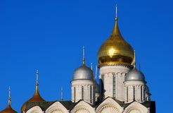 Old orthodox Archangels church. Moscow Kremlin. UNESCO World Heritage Site. Blue sky background Royalty Free Stock Image