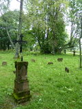 Old Orthodox cemetery with tombstones and stone cross. Stock Photos