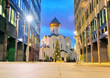 Old orthodox church between office centres in Moscow Stock Image