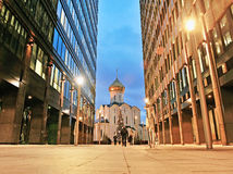 Old orthodox church between office centres in Moscow downtown Stock Photo