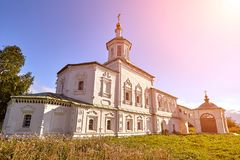 Old orthodox church at village. Summer view with floral meadow. Sun flare. Old orthodox church at village. Summer view with floral meadow. Sunny day, blue sky royalty free stock photography