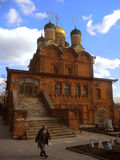 Old Orthodox Church. And old woman on March 13, 2016 in Moscow, Russia Royalty Free Stock Photography