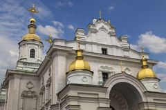 Orthodox Church. Poltava. Ukraine. Old Orthodox Dormition Cathedral Kiev Patriarchate. Gold domes close-up against a blue cloudy sky. Monument of architecture of Royalty Free Stock Photography