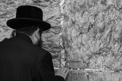 Old Orthodox Jew sticks a note into the western Wall or Wall of. Western Wall, Jerusalem, Israel 03.04.2015: Western Wall Jerusalem is also called the wailing Royalty Free Stock Photos