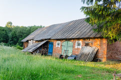 Old outbuilding with colored doors rural meadow Royalty Free Stock Photography