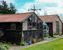 Old outbuildings and shed seen in an English back garden. Royalty Free Stock Photography