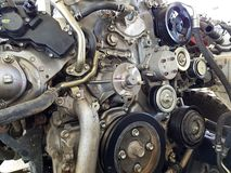 An old outdated engine, a closeup shot, engine car broken.  royalty free stock image