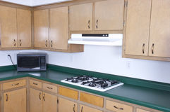 Old Outdated Kitchen Cabinets Needs Remodeling Royalty Free Stock Image