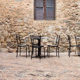 Old outdoor cafe in a traditional tuscany street Stock Images