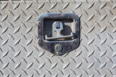 Old outdoor steel utility cover with diamond plating. Close-up of old outdoor steel utility cover with diamond plating Royalty Free Stock Photo