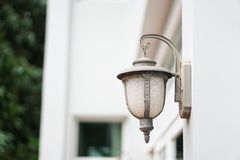 Old outdoor wall lamp light on white exterior Royalty Free Stock Images