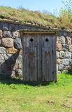Outdoor wooden toilet cabin for men and women in Daugavpils, Latvia. Old outdoor wooden toilet cabin for men and women against the backdrop of Daugavpils Stock Photos