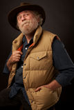Old outdoors man with hand in pocket Stock Photo