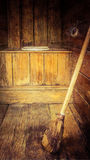 Old outhouse with broom Stock Image