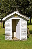 Old outhouse with open door Stock Photos