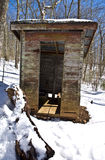 Old Outhouse in the Snow Stock Image