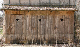 Old outhouses. With a classic heart in the wooden door Royalty Free Stock Image