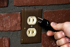 Old outlet and new plug Royalty Free Stock Images