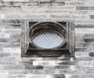 Old oval window with bars. Royalty Free Stock Images