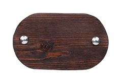 Old oval wooden board with chrome bolts. Isolated royalty free stock photography