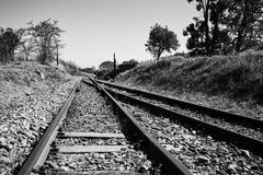 Old overgrown used railway tracks intersection merge artistic co Stock Image