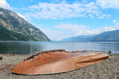 Old overturned boat on the  lake. Old overturned boat on the background of the lake Stock Photography