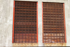 Old oxidated window in detail. Old metal windows oxidated in detail Royalty Free Stock Image