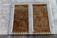 Old oxidated window ind etail. Old metal windows in detail Stock Photos