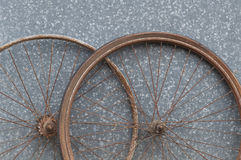 Old oxidized and damaged bicycle wheels Stock Photos