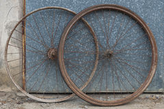 Old oxidized and damaged bicycle wheels Royalty Free Stock Image